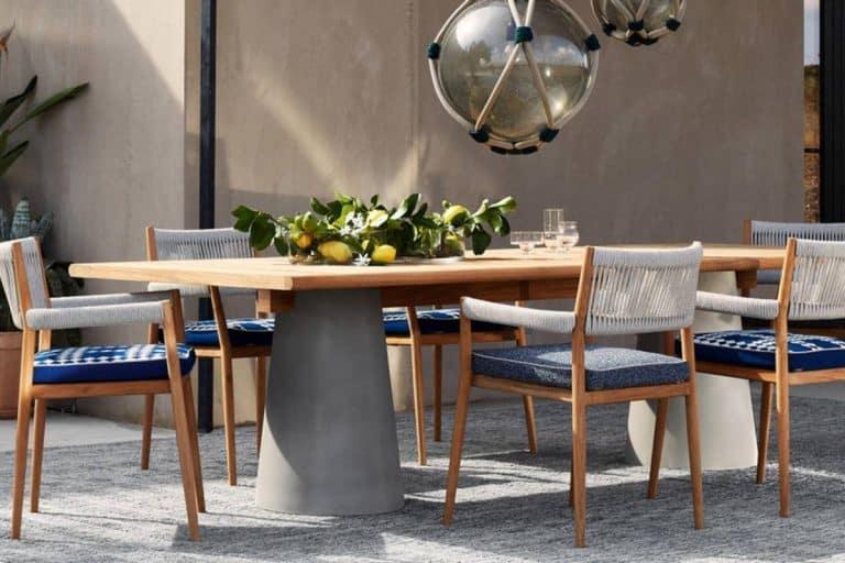 477 Dine Out: tavolo per esterni con base in cemento e piano in massello di teak - Cassina